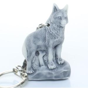Волк на скале (барельеф) / брелок
