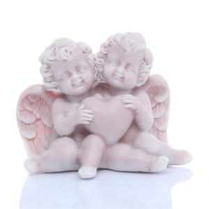 Ангелочки сидящие с сердечком